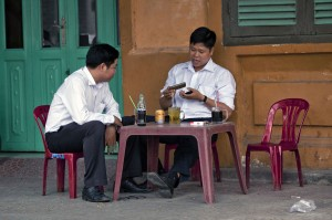 A streetside coffe shop. God knows and hears every day to day concern shared among the people.