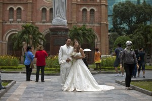A common site in HCMC, wedding photography with the architecture of the Duc Ba Cathedral in the background.