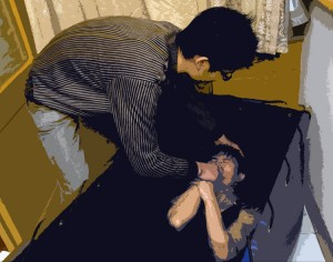 A young Believer is baptized in a house church.