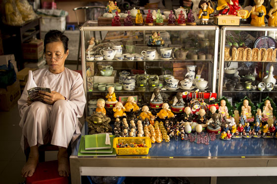 Some idle time for the shop worker selling idol.