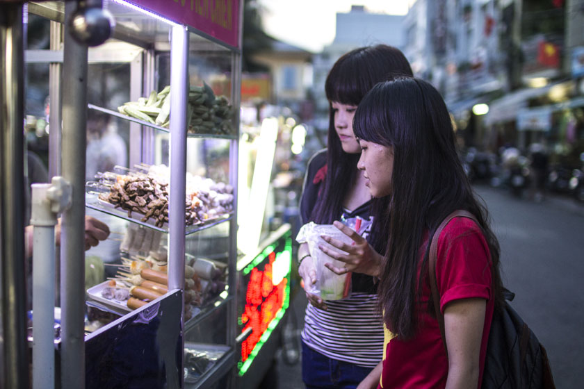 Delicious decisions. My new friends ordering our dinner from a street vendor.