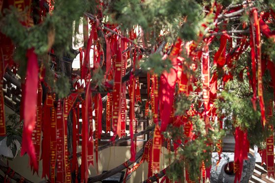 Red ribbons placed at the temple representing prayers.