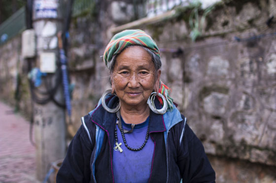 A black H'mong woman in busy center of Sapa.