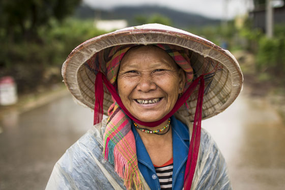 A Lao Lu woman smiles for my camera on her way to the fields.